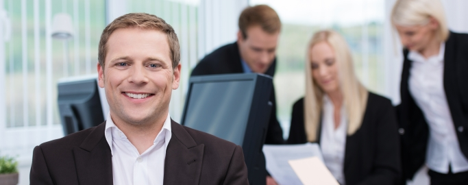 Smiling successful young businessman